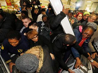 """Shoppers compete to purchase retail items on """"Black Friday"""" at an Asda superstore in Wembley, north London"""