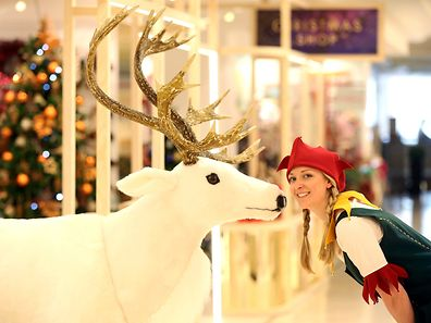 An Elf poses for a photograph in the Christmas Shop, at Selfridges department store, on Oxford street, London August 3, 2015. Selfridges opened its Christmas Shop today. REUTERS/Paul Hackett