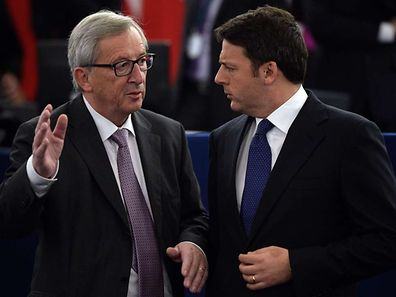 Italian Prime Minister Matteo Renzi talks with European Commission President Luxembourg Jean-Claude Juncker before the arrival of Pope Francis at the European Parliament, on November 25