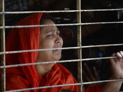 A relative of dead Bangladeshi blogger Washiqur Rahman reacts after seeing his body at Dhaka Medical College in Dhaka on March 30, 2015, after he was killed in an attack in the Bangladeshi capital. Police have arrested two men over the murder which comes just weeks after a US atheist blogger was also hacked to death in Dhaka, a crime that triggered international outrage, the officer said. AFP PHOTO/Munir uz ZAMAN
