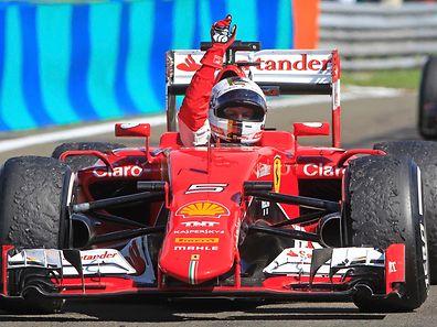 Winner Ferrari Formula One driver Sebastian Vettel of Germany celebrates after the Hungarian F1 Grand Prix