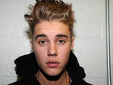 This file photo made available by the Miami Beach Police Dept., shows Justin Bieber at the police station in Miami Beach, Florida