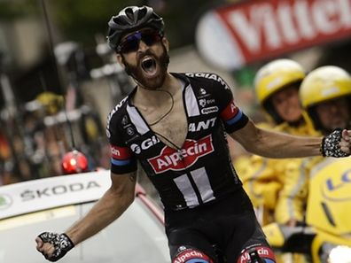 Germany's Simon Geschke celebrates as he crosses the finish line at the end of the 161 km seventeenth stage of the 102nd edition of the Tour de France cycling race on July 22, 2015