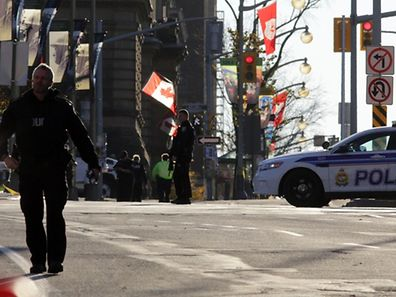 Police officers secure the area near Parliament Hill on October 22, 2014 in Ottawa, Canada.