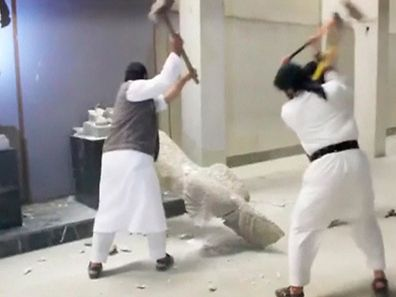 Men use sledgehammers on a toppled statue in a museum at a location said to be Mosul in this still image taken from an undated video. Ultra-radical Islamist militants in northern Iraq have destroyed a priceless collection of statues and sculptures from the ancient Assyrian era, inflicting what an archaeologist described as incalculable damage to a piece of shared human history.