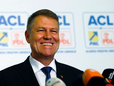 Romania's president elect Klaus Iohannis smiles during a news conference in Bucharest November 17, 2014.