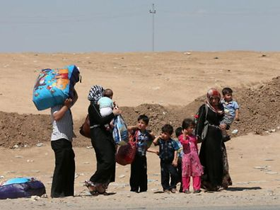 File photo of Iraqi displaced people, who have fled violence in Iraq's northern Nineveh province,