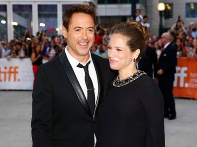Cast member and executive producer Robert Downey Jr. (L) and his wife, producer Susan Downey