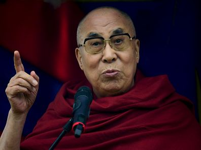 The Dalai Lama greets well wishers as he addresses a crowd gathered at the Stone Circles at Worthy Farm in Somerset during the Glastonbury Festival