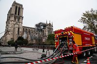 Firefighters continue to secure Notre-Dame Cathedral in Paris on April 16, 2019, in the aftermath of a fire that caused its spire to crash to the ground. - Crowds of stunned Parisians and tourists -- some crying, others offering prayers -- watched in horror in central Paris on April 15 night as firefighters struggled for hours to extinguish the flames engulfing the Notre-Dame Cathedral. (Photo by Zakaria ABDELKAFI / AFP)