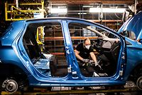 (FILES) This file photo taken on May 6, 2020 in Flins-sur-Seine, shows the assembly line that produces both the electric vehicle Renault Zoe and the hybrid vehicle Nissan Micra, the largest Renault production site in France. - France is preparing a package of measures to shore up automakers stung by the coronavirus crisis, including subsidies to encourage purchases of electric vehicles, Finance Minister Bruno Le Maire said May 18, 2020. (Photo by Martin BUREAU / AFP)