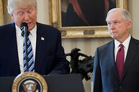 """(FILES) In this file photo taken on February 9, 2017, US President Donald Trump speaks alongside US Attorney General Jeff Sessions after Sessions was sworn in as Attorney General in the Oval Office of the White House in Washington, DC. - Sessions said he was resigning on November 7, 2018 at the request of US President Donald Trump in a move that raises questions over the future of the probe into Trump's alleged collusion with Russia. """"At your request I am submitting my resignation,"""" Sessions wrote in his letter to Trump. (Photo by SAUL LOEB / AFP)"""