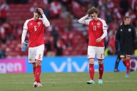 Denmark's defender Andreas Christensen and Denmark's forward Andreas Skov Olsen (R) walk off the pitch at the end of the UEFA EURO 2020 Group B football match between Denmark and Finland at the Parken Stadium in Copenhagen on June 12, 2021. (Photo by Friedemann Vogel / POOL / AFP)