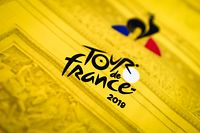 "(FILES) This file photo taken on May 14, 2019 in Romilly-sur-Seine shows a closeup of the yellow jersey of the 2019 Tour de France Cycling race during its making at the production line of French sport gear brand ""le Coq Sportif."" (Photo by Philippe LOPEZ / AFP)"