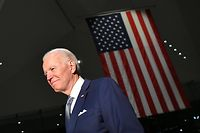 TOPSHOT - Democratic presidential hopeful former Vice President Joe Biden walks out after speaking at the National Constitution Center in Philadelphia, Pennsylvania on March 10, 2020. (Photo by Mandel NGAN / AFP)