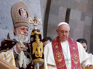 Pope Francis (R) and Catholicos of All Armenians Karekin II (L) leave at the end of the Divine Liturgy at the Armenian Cathedral in Etchmiadzin, Armenia, June 26, 2016. REUTERS/Alessandro Bianchi