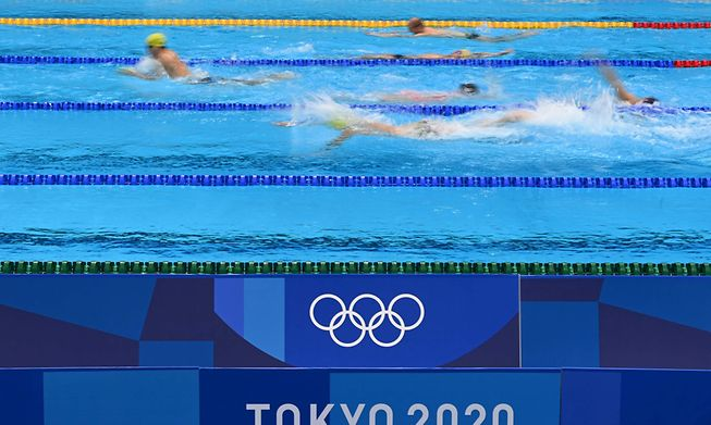 Athletes take part in a swimming training session at the Tokyo Aquatics Centre in Tokyo on July 21, 2021, ahead of the Tokyo 2020 Olympic Games.