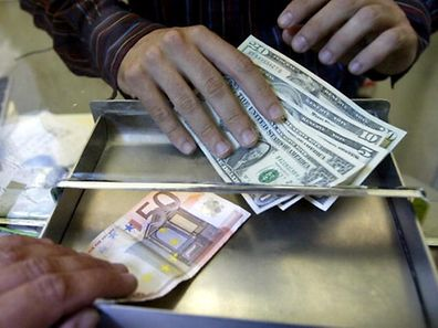 ** FILE ** A money changer employee changes Euro and US Dollars on an exchange kiosk, in downtown Milan, Italy, July 5, 2005. The euro soared to a new high against the U.S. dollar on Tuesday July 10, 2007, reaching US$1.3696 in afternoon trading in Europe before falling back slightly. The 13-nation currency was trading at US$1.3694, above the previous high of US$1.3682 it bought on April 27, and above the US$1.3623 it bought in New York late Monday. (AP Photo/Luca Bruno)