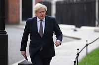 """Britain's Prime Minister Boris Johnson on his way to giving an update on relaxing restrictions imposed on the country during the coronavirus covid-19 pandemic at a virtual press conference inside the Downing Street Briefing Room in central London on July 5, 2021. - Prime Minister Boris Johnson will on Monday unveil a plan to lift most if not all of England's pandemic restrictions from July 19, as he urged the public to """"learn to live with"""" the coronavirus. (Photo by DANIEL LEAL-OLIVAS / POOL / AFP)"""