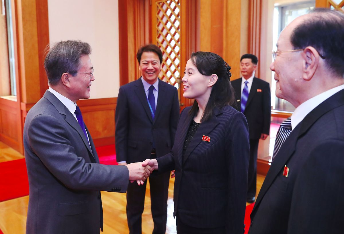 South Korea's President Moon Jae-in greets North Korean leader Kim Jong Un's sister Kim Yo Jong as North Korea's ceremonial head of state Kim Yong Nam (R) looks on before their meeting at the presidential Blue House in Seoul on February 10, 2018 (AFP)