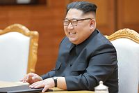 """This photograph taken on May 26, 2018 and released by North Korea's official Korean Central News Agency (KCNA) on May 27 shows North Korea's leader Kim Jong Un attending a meeting with South Korea's President Moon Jae-in during their second summit at the north side of the truce village of Panmunjom in the Demilitarized Zone (DMZ). Kim Jong Un believes a summit with US President Donald Trump will be a landmark opportunity to end decades of confrontation, South Korea's President Moon Jae-in said May 27 following his surprise meeting with the North Korean leader. / AFP PHOTO / KCNA VIA KNS / - /  - South Korea OUT / REPUBLIC OF KOREA OUT   ---EDITORS NOTE--- RESTRICTED TO EDITORIAL USE - MANDATORY CREDIT """"AFP PHOTO/KCNA VIA KNS"""" - NO MARKETING NO ADVERTISING CAMPAIGNS - DISTRIBUTED AS A SERVICE TO CLIENTS THIS PICTURE WAS MADE AVAILABLE BY A THIRD PARTY. AFP CAN NOT INDEPENDENTLY VERIFY THE AUTHENTICITY, LOCATION, DATE AND CONTENT OF THIS IMAGE. THIS PHOTO IS DISTRIBUTED EXACTLY AS RECEIVED BY AFP.  /"""