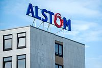 "Picture taken on March 30, 2017 shows the logo of Alstom, the manufacturer of French high-speed trains, on the company's plant in Salzgitter, central Germany. Alstom and German industrial giant Siemens said on September 27, 2017 they are to merge their rail activities in a politically tricky deal to create ""a new European champion"" big enough to take on world leader CRRC of China. / AFP PHOTO / dpa / Hauke-Christian Dittrich / Germany OUT"