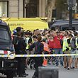 """Policemen check the identity of people standing with their hands up after a van ploughed into the crowd, killing two persons and injuring several others on the Rambla in Barcelona on August 17, 2017. A driver deliberately rammed a van into a crowd on Barcelona's most popular street on August 17, 2017 killing at least two people before fleeing to a nearby bar, police said.  Officers in Spain's second-largest city said the ramming on Las Ramblas was a """"terrorist attack"""" and a police source said one suspect had left the scene and was """"holed up in a bar"""". The police source said they were hunting for a total of two suspects. / AFP PHOTO / Josep LAGO"""