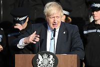Britain's Prime Minister Boris Johnson gives a speech during a visit with the police in West Yorkshire, northern England, on September 5, 2019. - UK Prime Minister Boris Johnson called Thursday for an early election after a flurry of parliamentary votes tore up his hardline Brexit strategy and left him without a majority. Johnson was on a campaign footing on September 5 as he launched a national effort to recruit 20,000 police officers in Yorkshire in northern England. (Photo by Danny Lawson / POOL / AFP)