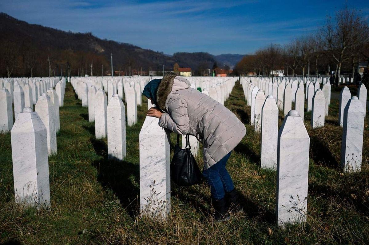 A woman kisses a relative's grave at the memorial centre of Potocari near Srebrenica.