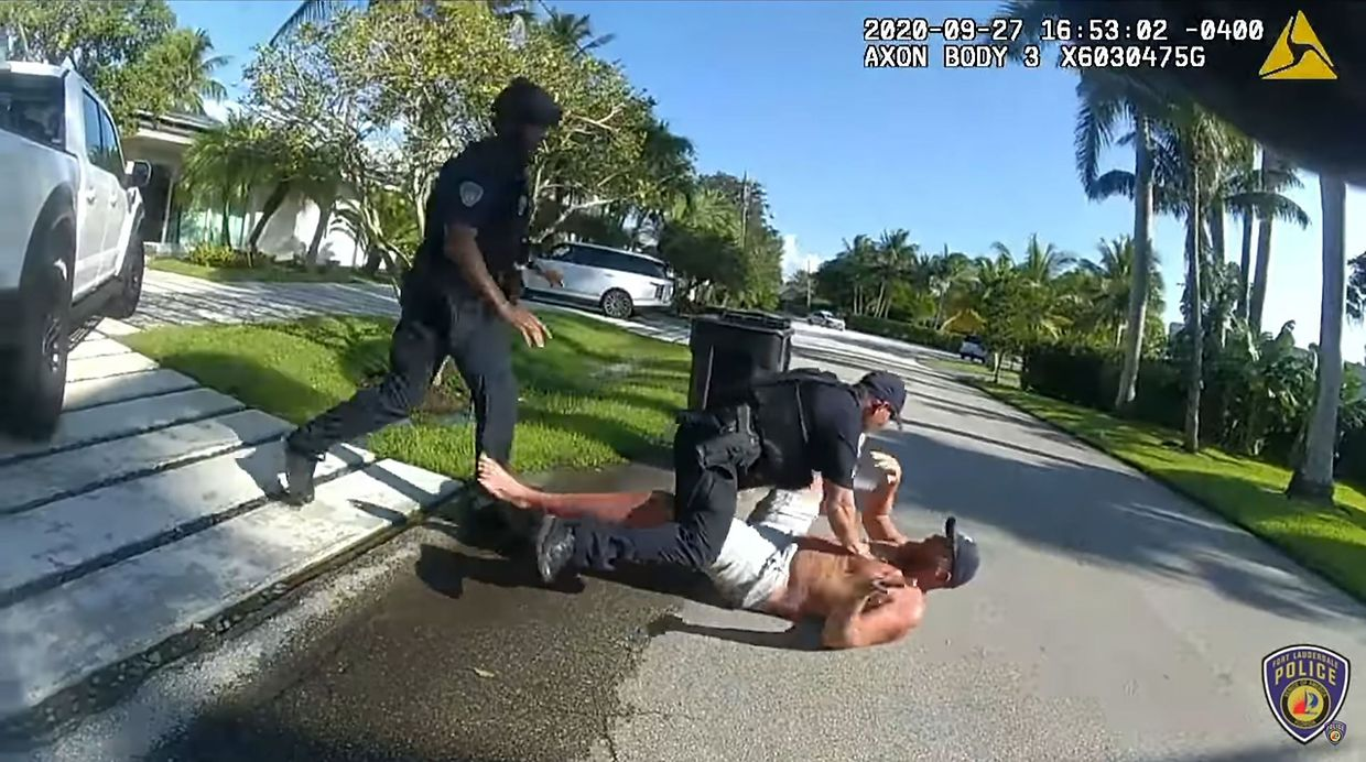 "This video grab taken from a handout video released by Fort Lauderdale Police Department on September 28, 2020, shows Donald Trump's former campaign manager Brad Parscale (R) being arrested outside his home in Fort Lauderdale, Florida on September 27, 2020. - Donald Trump's former campaign manager Brad Parscale was taken to a Florida hospital after his wife told officers he threatened to commit suicide, media reports said on September 27, 2020. (Photo by - / Fort Lauderdale Police Department / AFP) / RESTRICTED TO EDITORIAL USE - MANDATORY CREDIT ""AFP PHOTO / FORT LAUDERDALE POLICE DEPARTMENT "" - NO MARKETING - NO ADVERTISING CAMPAIGNS - DISTRIBUTED AS A SERVICE TO CLIENTS"