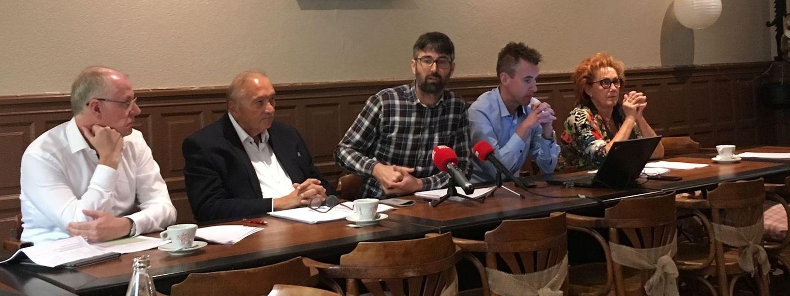 Vertreter von LSAP, Déi Lénk und DP bei der Pressekonferenz.