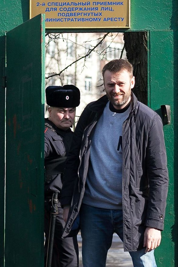 This file photo taken on March 6, 2015 shows Russian anti-Kremlin opposition leader Alexei Navalny (R) leaving a detention centre in Moscow.