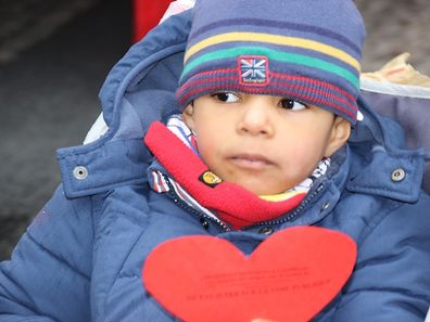 Refugees offer Valentine's hearts to Luxembourg City market shoppers