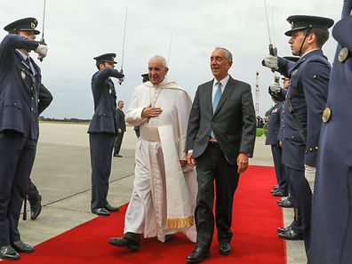 Pope Francis (C--L) accompanied by Portuguese President Marcelo Rebelo de Sousa (C-R) upon his departure from Monte Real Air Base, in Leiria, Portugal, 13 May 2017. Pope Francis celebrated a Holy Mass with the canonization of the little shepherds Jacinta and Francisco Marto at Holy Rosary Basilica in the Shrine of Our Lady of Fatima, which he was visiting on 12 and 13 May on the occasion of the 100th anniversary of the apparent appearances of the Virgin Mary to three shepherd children in 1917. JOAO RELVAS/POOL/LUSA