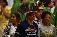 Representative of one of the Amazon Rainforest's ethnic group take part in a Pope's mass on October 6, 2019 at St. Peter's Basilica in the Vatican, for the opening of the Special Assembly of the Synod of Bishops for the Pan-Amazon Region. - Pope Francis will gather Catholic bishops at the Vatican on October 6 to champion the isolated and poverty-struck indigenous communities of the Amazon, whose way of life is under threat. (Photo by Tiziana FABI / AFP)