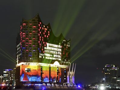 "The new landmark the ""Elbphilharmonie"" (Philharmonic Hall) along the Elbe river is illuminated during the opening of the new concert hall in Hamburg, northern Germany, January 11, 2017. REUTERS/Fabian Bimmer"