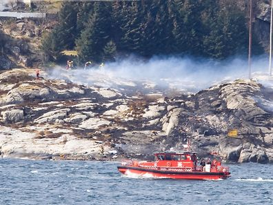Rescue forces work at the shore west of Bergen, Norway after a helicopter transporting 13 workers from an offshore oil field in the North Sea crashed off on April 29, 2016.