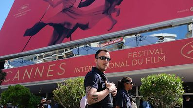 Police officers patrol in front of the Palais des Festivals along the top end of The Croisette on May 16, 2017 in Cannes, on the eve of the opening of the 70th Cannes Film Festival.  / AFP PHOTO / Alberto PIZZOLI