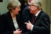 European Commission President Jean-Claude Juncker (R) gestures as he welcomes British Prime Minister Theresa May (L) after her arrival at the EU headquarters in Brussels to hold a meeting on Brexit talks on February 20, 2019. (Photo by JOHN THYS / AFP)