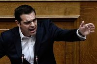 Greek Prime Minister Alexis Tsipras gestures as he delivers a speech during a parliamentary session in Athens on December 19, 2017. / AFP PHOTO / Angelos TZORTZINIS