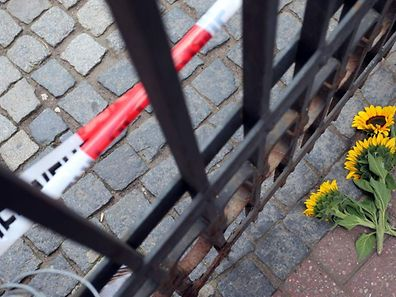 Flowers are laid down at the site of a sucide bombing in Ansbach, southern Germany, on Monday.