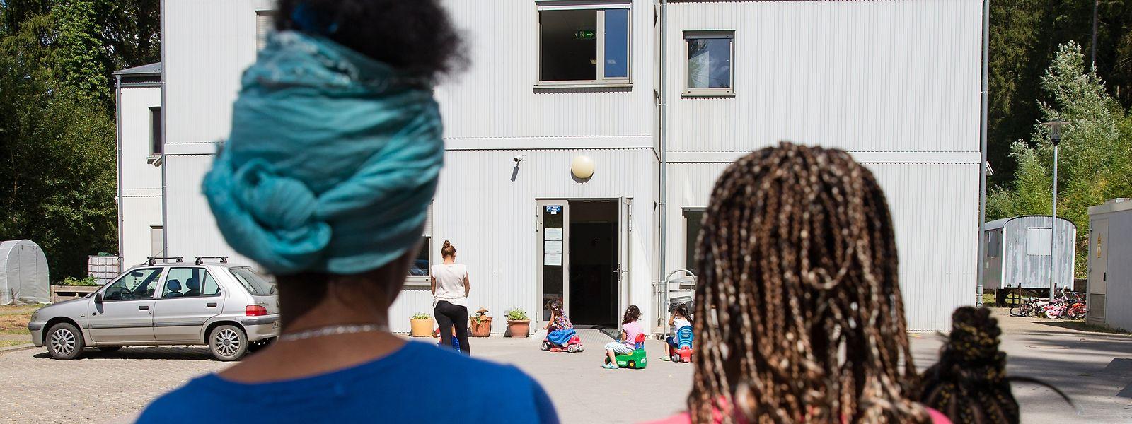 Flüchtlinge im Foyer pour refugiés Marienthal.