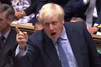 "A video grab from footage broadcast by the UK Parliament's Parliamentary Recording Unit (PRU) shows Britain's Prime Minister Boris Johnson speaking during his first Prime Ministers Questions session in the House of Commons in London on September 4, 2019. - Prime Minister Boris Johnson headed into a fresh Brexit showdown in parliament on Wednesday after being dealt a stinging defeat over his promise to get Britain out of the EU at any cost next month. (Photo by - / PRU / AFP) / RESTRICTED TO EDITORIAL USE - MANDATORY CREDIT "" AFP PHOTO / PRU "" - NO USE FOR ENTERTAINMENT, SATIRICAL, MARKETING OR ADVERTISING CAMPAIGNS - EDITORS NOTE THE IMAGE HAS BEEN DIGITALLY ALTERED AT SOURCE TO OBSCURE VISIBLE DOCUMENTS"