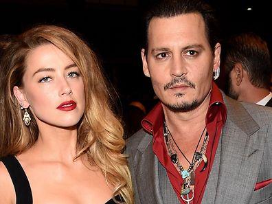 Johnny Depp et Amber Heard lors de leur premier anniversaire de mariage.