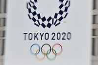 The Tokyo 2020 Olympic Games logo is pictured in Tokyo on March 26, 2020, two days after the historic decision to postpone the 2020 Tokyo Olympic Games. (Photo by CHARLY TRIBALLEAU / AFP)