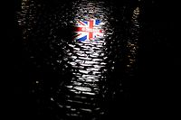 TOPSHOT - A picture taken on January 30, 2020 shows the reflection of a Union Jack flag on the ground during an event to celebrate the friendship between Belgium and Britain, at the Grand-Place, in Brussels, on January 30, 2020. - Britain's departure from the European Union was set in law on January 29, amid emotional scenes, as the bloc's parliament voted to ratify the divorce papers. After half a century of sometimes awkward membership and three years of tense withdrawal talks, the UK will leave the EU at midnight Brussels time (2300 GMT) on January 31, 2020. (Photo by Kenzo TRIBOUILLARD / AFP)