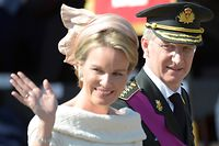 Belgium's King Philippe, right, and his wife Queen Mathilde wave as they arrive for a military parade in Brussels on Sunday, July 21, 2013. Philippe has taken the oath before parliament to become Belgium's seventh king after his father Albert II abdicated as the head of this fractured nation. Earlier Sunday, the 79-year-old Albert signed away his rights as the kingdom's largely ceremonial ruler at the royal palace in the presence of Prime Minister Elio Di Rupo, who holds the political power in this 183-year-old parliamentary democracy. Standing center is Queen Mathilde. (AP Photo/Ezequiel Scagnetti)