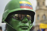 TOPSHOT - A Venezuelan opposition supporter living in Colombia takes part in a demonstration to back Venezuelan opposition leader Juan Guaido's calls for early elections, at Plaza de Bolivar square in Bogota, on February 2, 2019. - Tens of thousands of protesters were set to pour onto the streets of Caracas to back self-proclaimed acting president Guaido's calls for early elections as international pressure increased on President Nicolas Maduro to step down. Major European countries have set to Sunday deadline for Maduro to call snap presidential elections. (Photo by Diana SANCHEZ / AFP)