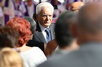 Italy's President Sergio Mattarella meets victims' relatives prior to the mass for the first anniversary of the Morandi bridge fall, on August 14, 2019 in Genoa. - Italy on August 14, 2019 marks a year since the Genoa motorway bridge collapse that killed 43 people, as the country grapples with a political crisis sparked by far-right leader. The ceremony takes place close to the spot where a section of the Morandi highway fell during heavy rain on August 14, 2018, hurling dozens of cars and several trucks onto railway tracks below. (Photo by Alberto PIZZOLI / AFP)