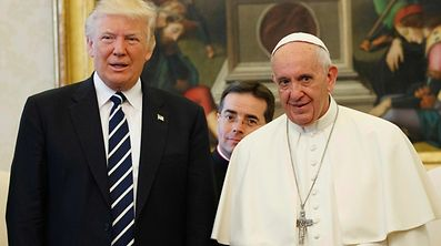 Pope Francis stands with US President Donald Trump during a private audience at the Vatican on May 24, 2017